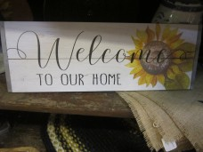'Welcome to our Home' sign